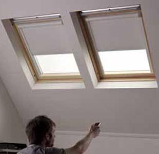 Solar powered blackout blinds for skylights